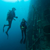 Divers explore the wreck of a tuna trawler in Marovo Lagoon.